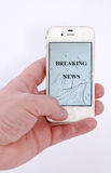 Breaking news on a mobile phone. With a broken screen royalty free stock image