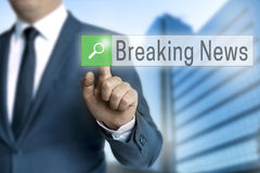 Breaking news browser is operated by businessman.  stock photo