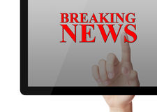 Breaking News. Hand touch the screen on tablet of Breaking news concept with white background Stock Photography