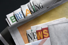 Breaking news on newspapers. Breaking news letters on newspapers Royalty Free Stock Image