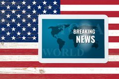 Breaking news splash screen on tablet pc over painted united sta Royalty Free Stock Photo
