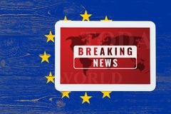 Breaking news splash screen on tablet pc. Over painted europe union flag Stock Photos