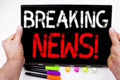 Breaking news text written on tablet, computer in the office with marker, pen, stationery. Business concept for newspaper breaking. News white background with royalty free stock image