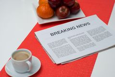 Breaking news on a white table at breakfast Stock Photo