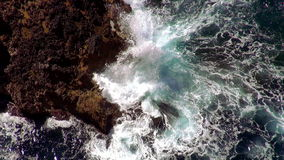 Breaking ocean waves at the cliffs aerial shot The Mediterranean sea stock footage
