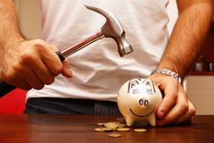Breaking the piggy bank Stock Photography