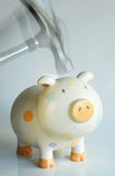 Breaking the piggy bank in action. Hammering the piggy bank in action Royalty Free Stock Image