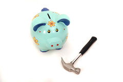Breaking piggy bank with hummer isolated Royalty Free Stock Photo