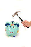 Breaking piggy bank with hummer isolated Stock Image