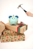 Breaking piggy bank with hummer  Royalty Free Stock Photography