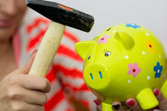 Breaking a porcelain piggy bank with a hammer Royalty Free Stock Photography