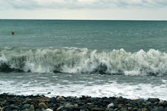 Breaking powerful waves at rising storm royalty free stock photo