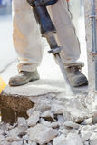Breaking reinforced concrete with jackhammer Stock Images