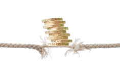 Breaking rope with coins Royalty Free Stock Images