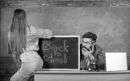 Breaking rules. School behaviour discipline rules. Teacher or school principal absorbedly looking buttocks sexy girl. Student. Student temptress. Student mini royalty free stock images