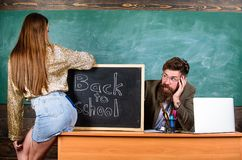 Breaking rules. Student temptress. School behaviour discipline rules. Teacher or school principal absorbedly looking. Buttocks girl student. Student mini skirt royalty free stock photos