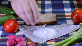 Breaking and salting bread stock video