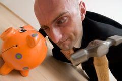 Breaking into savings Stock Photo