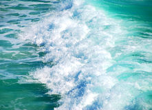 Breaking Surf. Aerial view of turquoise waves breaking at beach Royalty Free Stock Photos