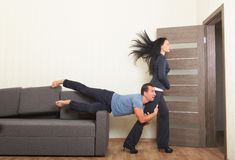 Breaking up, concept. Man desperately clinging to the leg of a woman Royalty Free Stock Photos