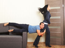 Breaking up, concept. Man desperately clinging to the leg of a woman Stock Photo