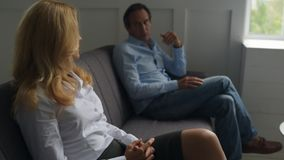 Upset pair having a talk with psychologist. Breaking up. Disappointed couple talking with psychologist while expressing their point of view and being displeased stock video
