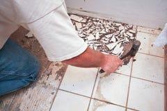 Breaking up floor tiles Royalty Free Stock Photo
