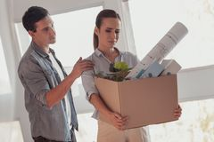 Nervous pretty woman preparing for leaving her boyfriend stock images