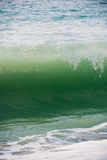 Breaking wave. Scenic view of crest of breaking wave in sea Stock Image
