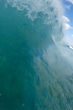 Breaking wave. A wave breaking up close royalty free stock photo