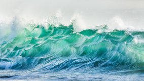 Breaking wave. On the beach Royalty Free Stock Photos