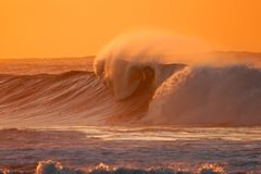 Breaking wave. Seascape at sunset with large breaking wave Stock Photos