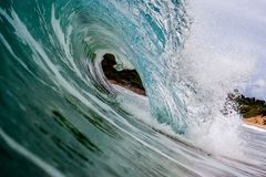 Breaking wave on the beach shore stock image