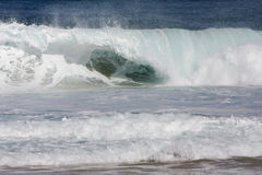 Breaking wave in big surf. Breaking shorebreak wave in big surf Stock Photography