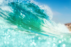 Breaking Wave with Bokeh. A breaking ocean wave with bright bokeh in the foreground.  Image made with subtle panning motion combined with a slow shutter speed Royalty Free Stock Photo