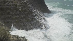 Breaking wave on cliff. Breaking ocean wave on cliff in slow motion stock video footage