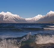 Breaking Wave and Mountains Royalty Free Stock Images