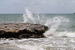 Breaking Wave. Wave breaking over rocks. Hervey Bay Royalty Free Stock Images