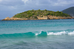 Breaking wave on Sant Elm beach. Stock Photos