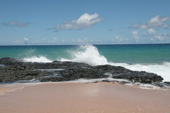 Breaking Waves. Waves breaking on volcanic rock in Kauai Royalty Free Stock Photography