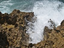 Breaking Waves. Waves break amidst the volcanic rock along the North Shore of Oahu royalty free stock images