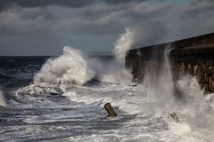 Breaking waves over Holyhead Breakwater Stock Images