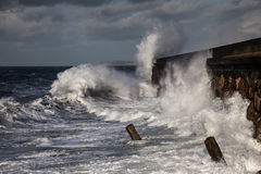 Breaking waves over Holyhead Breakwater Royalty Free Stock Image