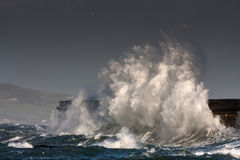 Breaking waves over Holyhead Breakwater Royalty Free Stock Photos