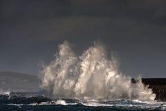 Breaking waves over Holyhead Breakwater Stock Images