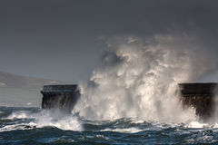 Breaking waves over Holyhead Breakwater Stock Photography