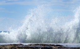Breaking waves on rocks. Waves break on rocks on the Queensland Coast, Australia Stock Images