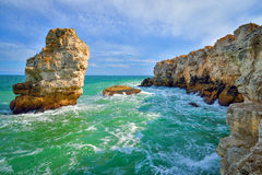 Breaking waves on the rocky coast of the Black Sea at Tyulenovo, Bulgaria Stock Photos