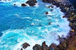Breaking of waves on rocky shore, Tenerife royalty free stock images
