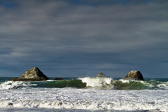 Breaking waves and sea stacks, Oregon Stock Image